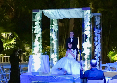 Acrylic Canopy Chuppah with Orchids Gems and Uplighting at the Bonaventure Resort & Spa