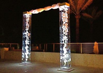 Modern & Chic Acrylic Wedding Arch with Gems & Silk Orchids with Uplighting