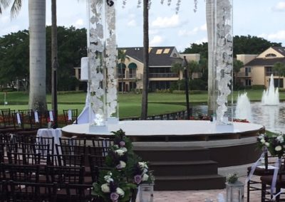 Acrylic Chuppah Gems Orchids and lights at the Brokensound Country Club