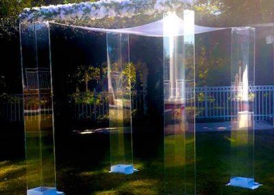 Acrylic Huppah Lake Mary with white flower bar and added fresh greenery