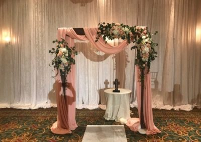 Dark Wooden Arch with Heavy Custom Draping