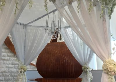 Mandap with chandelier and fresh flowers